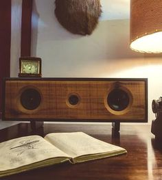 These wood speakers have a contemporary yet retro effect.  www.AmosEvents.com