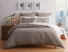 MILANO+BEDLINEN+SILVER quilt covers in both rooms. Each bed to have 2 white linen pillows (standard size) + 2 European in same colour as quilt cover + 2 cushions in chosen fabric.
