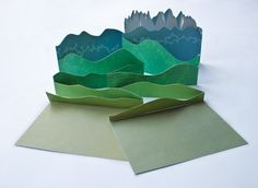 """an """"accordion book featuring a repositionable Alpine landscape"""" by Kevin Steele, via Green Chair Press"""