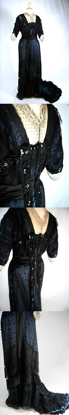 Dress, ca. 1910s, of blue silk with black silk lace overlay. Top of bodice and bottom of sleeve have decorative ivory lace with black embroidery detailing. High waist decorated with wide black satin ribbon that extends down the front and around bottom. Black beading along bust, on sleeves, down sides and on train. Beaded trim on back has large bead tassel at ends. From Emily P. Reynolds Historic Costume Collection.