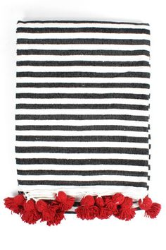 Striped Cotton Pom Pom Blanket by Bohemia Design. Working in ethical partnership with traditional Moroccan weavers, Bohemia Design has created a colorful collection of Berber Pom Pom blankets in 100% natural wool and cotton. The blankets are woven entirely by hand on wooden looms and decorated with giant poms poms in classic Berber style. The wools are dyed by the traditional dyers of the Marrakech souks. Handwoven in Morocco.