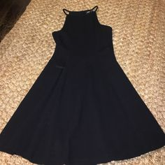 Asos black high neck stretchy swing dress Asos black high neck stretchy swing dress! Super comfy and can be dressed up or down! Size 4 best fits a small! ASOS Dresses Mini
