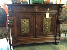 """Hand Carved Server or Buffet With Brass Panel Inserts   Dealer #0108  47"""" Wide x 20"""" Deep x 40"""" High   $1288  Lucas Street Antiques Mall 2023 Lucas Dr.  Dallas, TX 75219  Located close to"""