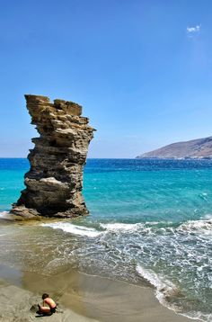 """Andros, Greece. This famous beach is called """"Grias Pidima"""" which roughly translates to """"the jump of the old lady"""". They say that an old lady jumped from the hill and killed herself because she had betrayed the greeks to the turks."""