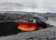 A fluid lava stream within the main tube of the June 27 lava flow from the Kilauea volcano Pahoa, Hawaii, Aug. 12, 2014. (AP Photo/U.S. Geological Survey)