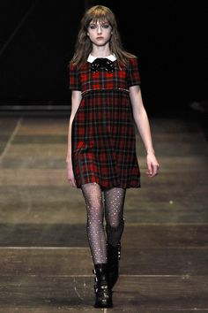 Hedi Slimane finds his inner grunge kid for Saint Laurent, Fall 2013.  The sheer tights are studded, I kid you not!