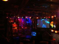 Watch a movie in the tiki lounge sitting at the bar.