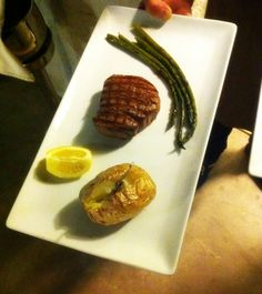 Beef fllet steak with grilled asparagus and baked potato with butter milk ready to be served! #SeenAtAlana #AlanaRestaurant #Rethymno