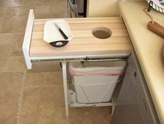 Pull-Out Cutting Board Over Garbage. Could be a nifty little compost drawer!