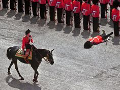 A foot guard passes out as Queen Elizabeth II rides past during the trooping the colour parade in June, 1970 Photograph: Gamma-Keystone