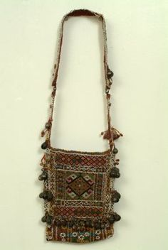 Bagobo Beaded Bag :Tie-dyed abaca fiber in a geometrical pattern with glass beads applied to the front and metal bells applied to the borders.