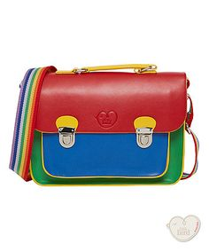 Let your little one revel in their true colours with the rainbow satchel. We've re-imagined the apple satchel for the new season in bright block colours - the perfect colours for summer! Combining an adjustable rainbow shoulder strap with a functional top handle. The satchel remains true to all the features you know and love from the classic satchel design: front pocket and double clip fastenings!