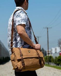 stylish man wearing brown canvas bike messenger bag by Serbags