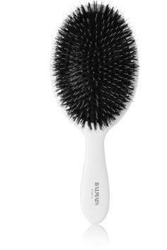 Balmain Paris Hair Couture's spa brush will keep your tresses glossy and tangle-free. This handmade tool is packed with black bristles that stimulate blood circulation to the root and close cuticles to ensure strong, supple and healthy hair.
