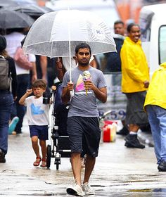 Aziz Ansari. With a huge ice cream cone and ridiculous umbrella. this kind of is the funniest thing ever.