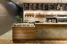 What a beautiful finish on the front of the cashwrap1 pano BROT & KAFFEE by DITTEL | ARCHITEKTEN, Stuttgart Germany cafe bakery