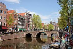 Bridge on Oudezijds Voorburgwal canal, city of Amsterdam, Holland, Netherlands.