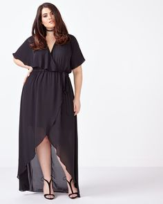 Special night planned? Wow them away in this stunning plus-size maxi dress from Melissa McCarthy! Crafted from a soft, fluid fabric, it has flowing short sleeves, ruffled wrap front, elastic waistband and crossover high-low hem. Kick it up with heels! Length: 64""