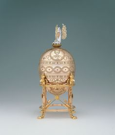 Fabergé firm (Russian , 19th century)  MikhailPerkhin, Workmaster (Russian , 1860 - 1903)  JohannesZehngraf, Painter of miniatures (Russian , 1857 - 1908)  Imperial Pelican Easter Egg  ca.1897    Gold, diamonds, enamel, pearls, watercolor on ivory  4 x 2.125 (diameter) in.