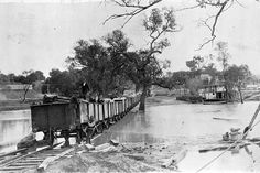 A train going through Murray River floodwaters . There is a paddle steamer in the background. Melbourne Victoria, Victoria Australia, Old Photos, Vintage Photos, Murray River, Small Fountains, Old Boats, Natural Wonders
