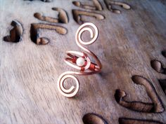 Hey, I found this really awesome Etsy listing at http://www.etsy.com/listing/151257490/wire-wrapped-adjustable-copper-ring