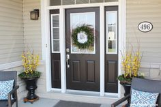 Decorating Tips to add curb appeal to your front entryway or porch. Includes tips for seating, containers, a wreath and door decor. www.settingforfour.com