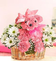 our perfectly pink puppy-shaped arrangement would be wonderful to welcome a new baby girl..