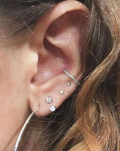 Let's hear it for this cute setup! A Crystal Paved conch hoop is an absolute must have for any ear piercing connoisseur! Conch Piercing Jewelry, Ear Jewelry, Body Jewelry, Conch Piercings, Tragus, Jewelry Box, Jewellery, Conch Hoop, Cute Piercings