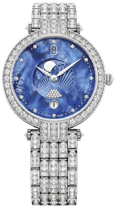 PRNQMP36WW006 Harry Winston  This Ladies watch has 36mm round 18K White Gold & Diamonds case & Diamond-set bezel and is being part of the Premier Collection, that was the first watch collection introduced by Harry Winston in 1989. Nowadays this collection is an iconic signature of the company, that captures the pioneering spirit of Harry Winston - the boldness to achieve uncompromised excellence and the creativity in watchmaking.  Blue beaded mother-of-pearl dial with blue mother-of-pearl moon p Simple Watches, Stylish Watches, Luxury Watches, French Women Style, Amazing Watches, Fossil Watches, Harry Winston, White Gold Diamonds, Bracelet Watch