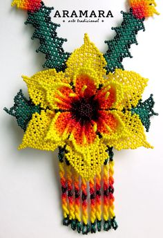 Lenght 15.5 inches (39.37 cms) The Huichol represent one of the few remaining indigenous cultures left in Mexico. They live in self-imposed isolation, having chosen long ago to make their home high in the mountains of the Sierra Madre Occidental, in Western Central Mexico. Huichol Art Seed Bead Flowers, Beaded Flowers, Seed Beads, Bead Earrings, Crochet Earrings, Collar Indio, Mexican Jewelry, Native American Beadwork, Beading Tutorials