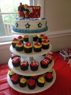 Fireman Sam cake and fondant helmet/ladder cupcakes for fireman party