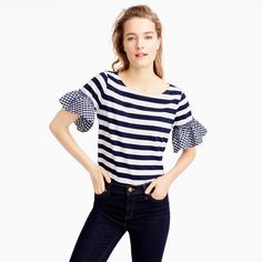 A classic tee + ruffly sleeves = a fun new way to mix things up. Body length: 23 1/2. Cotton. Machine wash. Import.
