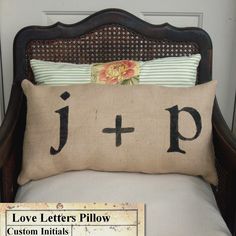 Love Letters - Burlap Pillow -  Feedsack Style - Personalize with you and your sweetie's initial - Custom Monogram Pillow. $35.00, via Etsy.