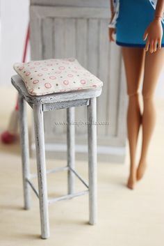 Glue wooden dowels to a stack of cardboard to make this rustic barstool. | 19 Adorable Barbie Accessories You Can Make For Your Kids