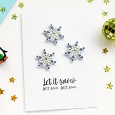 **PLEASE BE AWARE THAT ANY NON-EUROPENAN ORDERS PLACED AFTER 25TH NOVEMBER CAN NOT BE GUARANTEED IN TIME FOR CHRISTMAS**QUILLED SNOWFLAKE CHRISTMAS CARD Send snowy Christmas wishes with this quilled card featuring 3 mini snowflakes in and finished off with faux diamantes. The