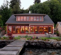 Lake house exterior exterior beach style with red trim contemporary look home