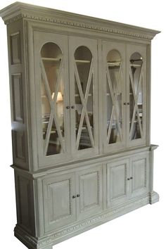 Double X Cabinet-The Double X Cabinet is a versatile piece that can be used from a Bookcase to a Display Server Hutch... The Doors are available in either Glass or Mirror.