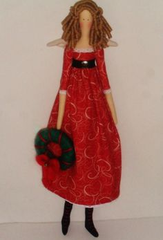 http://www.elo7.com.br/boneca-de-pano-tilda-natalina/dp/606CFF