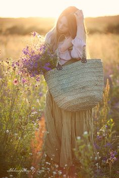 Romantic - this puts in my mind the idea to make a flower carrier - a fabric flat piece with handles on either skinny end so when carried, it will fold and cradle any flower you pick!