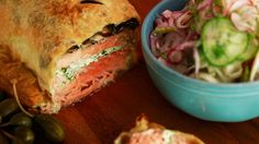 Get creative in the kitchen this week. Make Rachael's Garlic-Herb Salmon en Croute with Fennel and Cucumber Salad. #whatsfordinner
