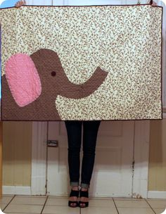 I like the idea of this.  Maybe I could enlarge my little dog applique pattern and do it bigger.