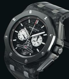 Audemars Piguet Royal Oak Offshore Tourbillon Chronograph 26550AU.OO.A002CA.01.  The large 44mm case is crafted from ultra-hard forged carbon, which they have pierced with their signature eight screws. The face is made of ultra-hard carbon, adding to it's impenetrable appearance and construction. The white hands and subdials contrast the blackened titanium tourbillon and the whole peice, which is beveled, grained and polished to perfection.