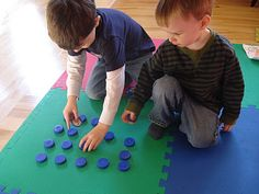 cut cardboard circles to put under the lids.  write numbers 1-10 on them for a recycled matching game