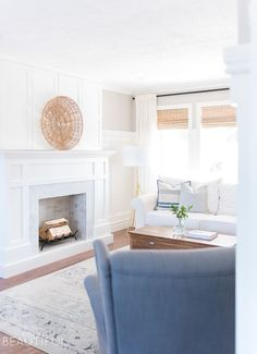 A classic craftsman style fireplace is the perfect addition to this coastal casual living room. A herringbone marble facade combined with bi-fold doors that easily open to reveal a hidden TV mix style and convenience. We are sharing the free plans here. #Fireplace #FireplaceIdeas
