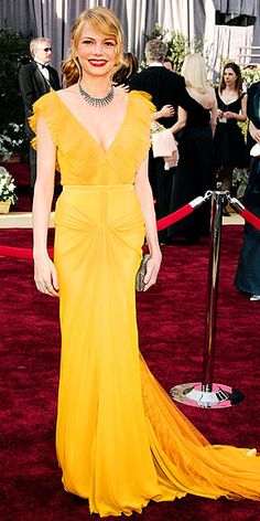 MICHELLE WILLIAMS, 2006  For her first Academy Awards appearance, Brokeback Mountain's Best Supporting Actress nominee already looked like a red carpet pro, walking arm-in-arm with partner Heath Ledger in a canary-yellow, pleated Vera Wang gown that is still considered one of the best Oscar dresses of all time.