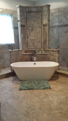 Walk - through shower; free standing bathtub; & waterfall bath filler with sprayer...don't forget to look at the finished picture with the chandelier in place and the lead glass window.