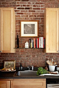 cookbooks well presented in the kitchen  -  A Perfumer and Teacher's 1900s Brownstone in Harlem | Design*Sponge