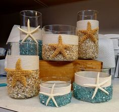 Vases adorned with seashells, sea glass, rope, and starfish #Beach #Nautical