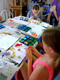 Painting game boards and sculpting the game pieces at Creative Arts Inc. summer art camp!