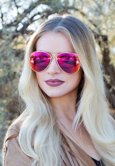 """Do you, our esteemed customer, take these sunnies to be you favorite accessory? OurDuffy Aviator Sunglasses in redfeaturea rose gold-colored metalframewith brow barand rubber nose protectors. Semi-tinted and iridescent reflective lenses with UVprotection.*2.25"""" Height*5.75"""" Length*Imported"""